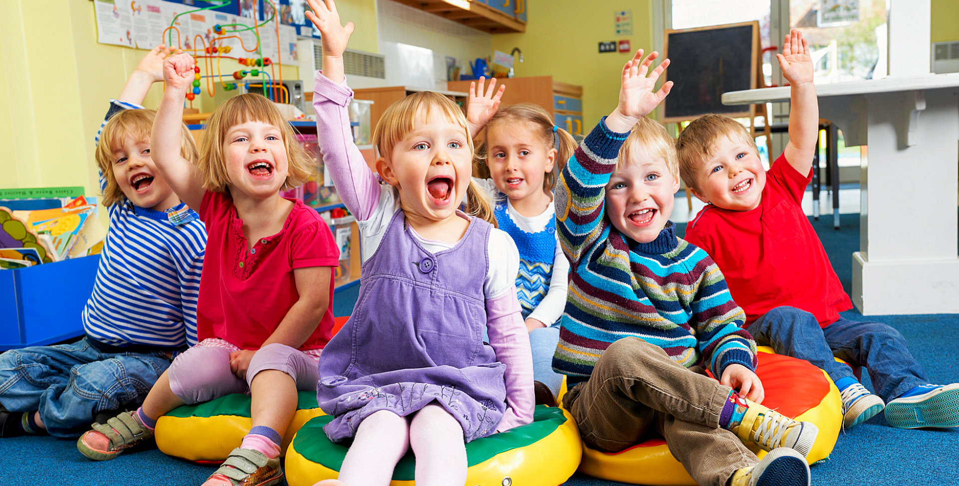 children raising their hands