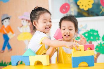 girls playing blocks